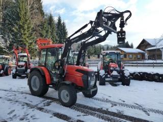 Kubot L1501 mit Alö Frontlader und Baumzange